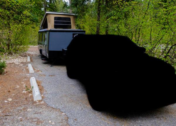 Hidden tow vehicle in front of Mantis Camper
