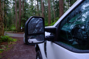 Ford tow mirror with rain drops on it