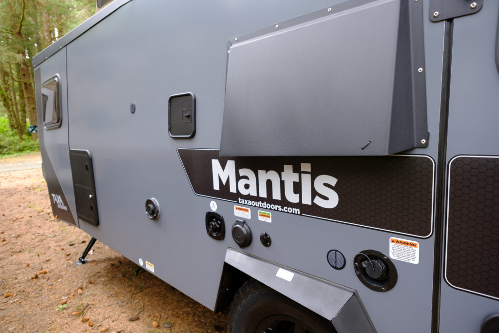The driver side exterior of the Mantis with all the city access ports