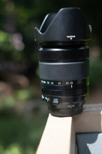 Image of Fuji 18–135 on a rail with a blurred background
