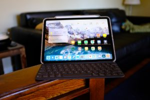iPad Pro sitting on the arm of living room chair