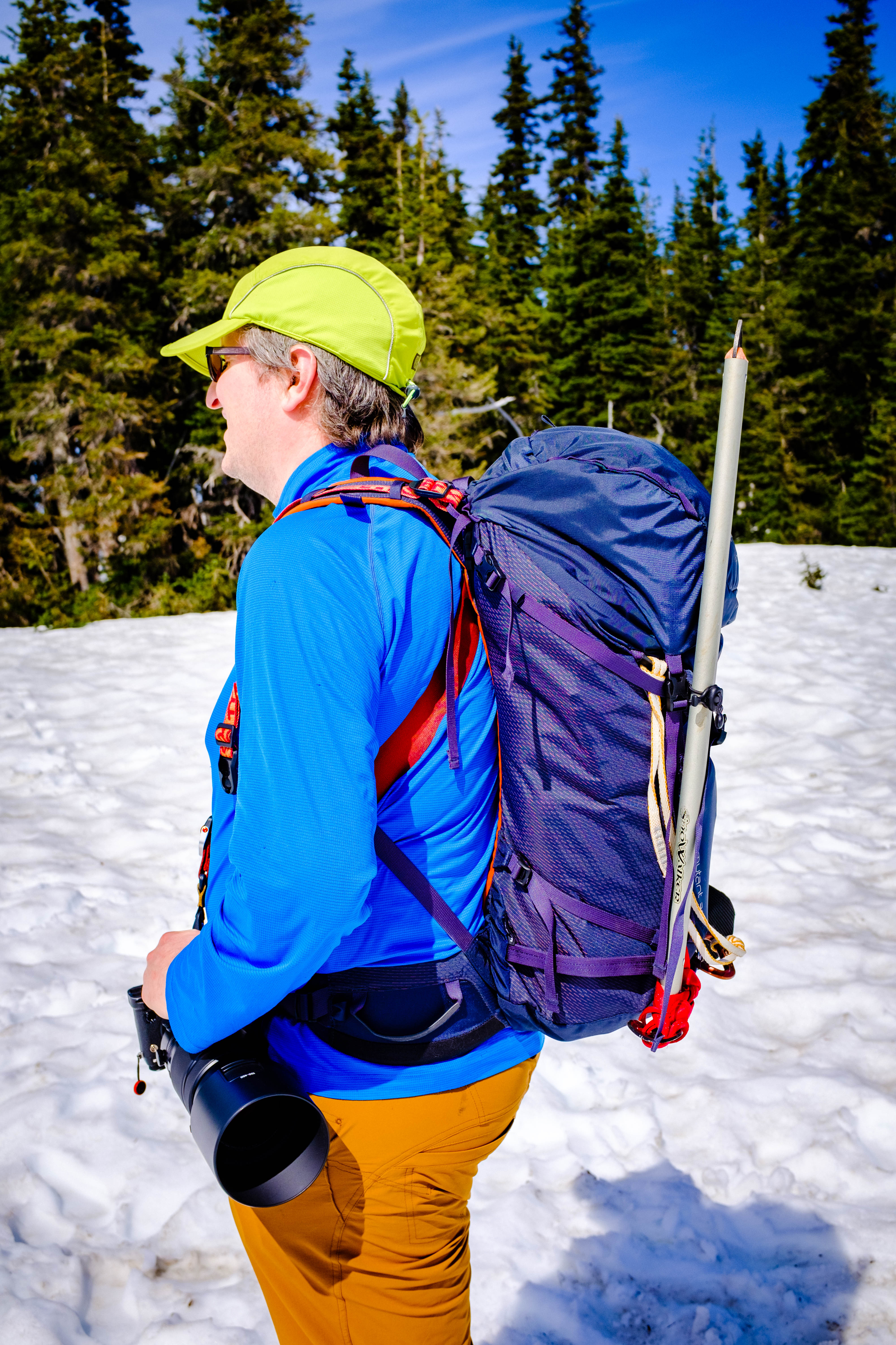 Osprey Mutant 38 mountaineering pack worn by the author on a sunny spring day in the mountains