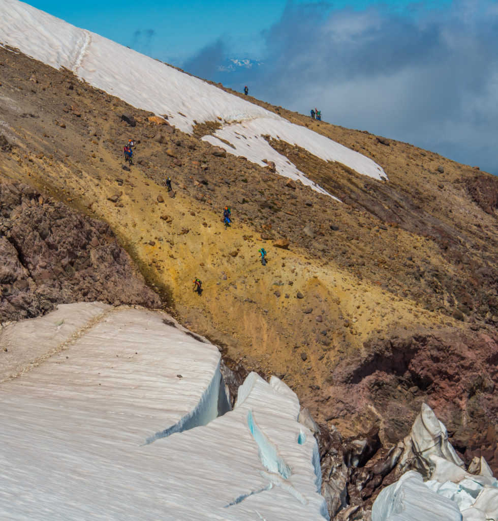 A team descending the moraine onto the Emmons glacier