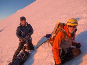 Taking a break along the slope of Mount Rainier, early morning sun on our backs