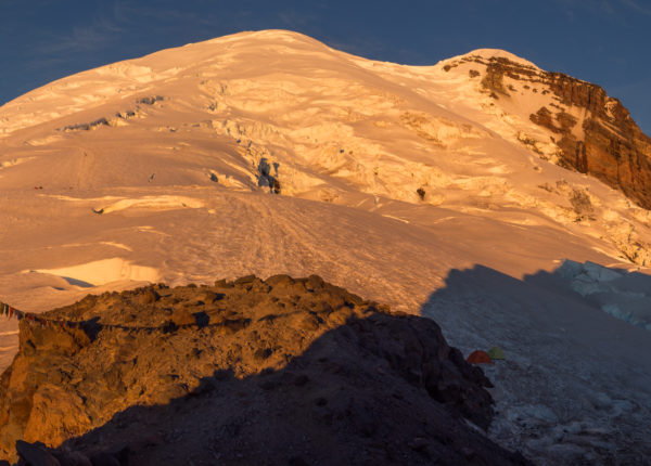 The glow of the early morning sun on Rainier from Schurman camp
